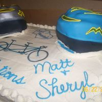 "Sheryl & Matt's Tandem Bike Cake full sheet (2- 11x15's) half white, half choc. Helmets are 7""ovals stacked on carved 6""rounds to get the angle. Thanks for..."