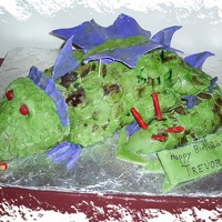 Trevor's Dragon Fondant covered carved cake, purple wings!