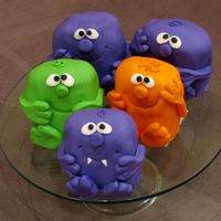 "Little Monsters This design is from Debbie Brown's ""50 Easy Party Cakes"" book. I ended up with orders for about 30 of these cakes and as..."
