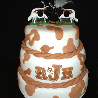 Longhorn Wedding Shower Cake This was made to compliment the invitation to the shower. The groom went to University of Texas and the Bride went to Texas Tech.