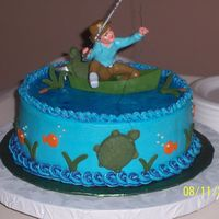 Fishing Grooms Cake white almond cake with raspberry fill. fondant turtles and grass. used piping gel for water
