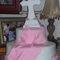My Daughters Baptismal Cake cross is a ceramic gift that was given to her. pink fondant drape