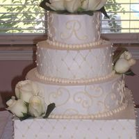 Mississippi Wedding white almond cake with raspberry fill. all buttercream with fresh flowers