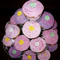 Pink Cupcake Tower Made for four year old birthday. Regular cupcake mix, topped with royal icing with sprinkles in different combinations. Wrapped tower with...