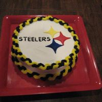 Steelers!   Pittsburgh Steelers Cake! The emblem was made with Colorflow!