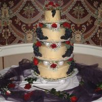 Wedding Cake - October 2007!  The Bride requested Grapes & Red flowers, which were both of her wedding day colors. She also requested Heart shaped cakes with Fondant...