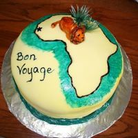 Bon Voyage This was my very first cake. My sister was leaving to go to Africa for a semester, so I made this cake for her going away party. I free...