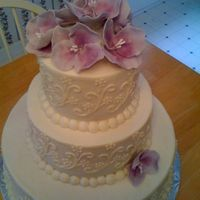 White On White With Purple WASC and Chocolate cakes with buttercream. Flowers are gumpaste.