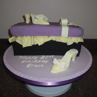 The Shoebox And Shoe Chocolate Biscuit Cake with Rice Krispie Box Lid, covered in fondant with Pastillage Shoe