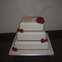 Roses & Swirls 3 Tier Square Ivory Cake with Soft Fondant Roses, Gold Wires and Royal Iced Swirls.