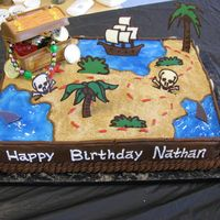 "Pirate's Treasure Mape Single Layer 11x15"" cake decorated as a pirate's treasure map with a plastic treasure trunk filled with plastic coins and..."