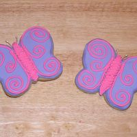 Butterfly Cookies  Purple butterfly sugar cookies decorated with pink swirl with white pearl antennae. All decorating is done in thinned royal icing, Body is...