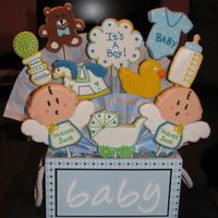 Baby Boy Cookie Bouquet Cookie Bouquet made for a Welcome Home for a Mom and her baby boy. Sugar Cookies outlined with Royal Icing and filled with royal icing run-...