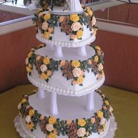 3-Tier Heart Shaped Wedding Cake W/royal Icing Flowers This cake was made for our contractor who is very earthy. It's a combination of his flair for fishing and camping and her feminity, so...