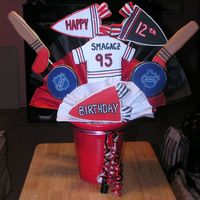 Hockey Birthdy Cookie Bouquet Birthday Cookie Bouquet for a Boy's Birthday. All of the templates were made from clipart. They pictures were enlarged and cut out of...