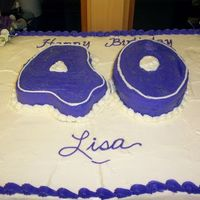 Lisas_Birthday.jpg 24x36 sheet yellow & chocolate cake, buttercream frosting. The40--one number is yellow the other chocolate