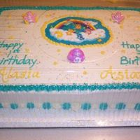 Care Bears Birthday Marble cake--double layer with buttercream frosting. Made for 2 little girages 1 & 3 who were more excited about the plastic rings on...