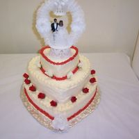 Small_Wedding.jpg   Same cake as the graduation cake, just decorated for a weddingThe guest count was around 50-60