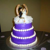 Purple Wedding Cake The Bride's favorite color is purple and she married a cattle rancher (she picked out the topper). Fondant white pearls, buttercream...