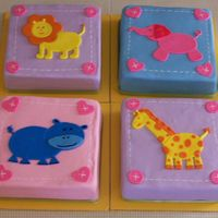 Baby Shower Cake This cake was a nightmare! The cakes kept cracking when I torted them. The fondant was too soft and showed every bump. crease. I couldn&#...