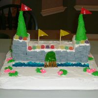 First Attempt At A Castle Cake Made several years ago for my 2nd grade class. The moat is blue jello. Cake is white cake with buttercream icing.
