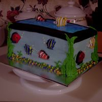 Aquarium Birthday Cake  This is a 3-layer butter flavored Aquarium cake I made for a friends son. The fish are Wilton candles cut in half. The top is blue piping...