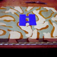 Camoflauge Promotion Cake  I made this cake for a promotion ceremony at my husbands work. He works for the Air Force. It is all buttercream rolled smooth with a...