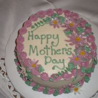 "Moms Mothers Day Cake   8"" carrot cake with cream cheese icing. I made the daisys from fondant."