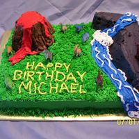 Dino Birthday Cake This is a chocolate cake with vanilla frosting. Everything is cake, except the dino's.