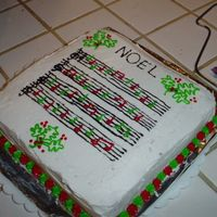 Sheet Music Cake I tried to make this cake look like a sheet music. The notes are in red and green to be festive