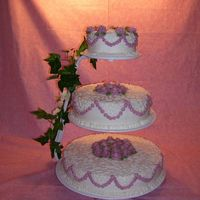 Wedding Cake With Mauve Roses This is an almond cake I did this for a wedding renewal. I had lots of fun making this. Was my first wedding cake.