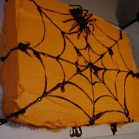 Spiderweb Cake This is a quick snapshot of my Halloween cake. It would have been a better picture if I would have taken it once I placed it on the glass...