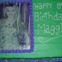 1May_2007_01111111.jpg I made this cake for a friends daughter. The theme of the party was Hannah Montana and she couldn't find a cake. So I did the best I...