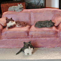 "Comfy Cats Client gave me photos of her four cats so they could be replicated on the cake. The couch is sculpted cake ""upholstered"" in..."