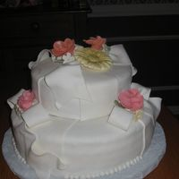 Fondant Cake W/roses & Gerber Daisies Very green at working with fondant & gum paste.