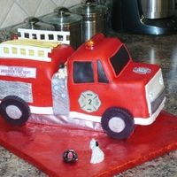 Firetruck Cake This was a white cake with buttercream and fondant icings. The headlights, rear strobes and light bar all lit up!! It was great fun to make...