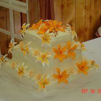 Orange Square Cake This cake was for my brother's wedding.. and my first attempt at something this large.. It was all butter cream with a strawberry...