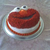 Elmo's 1St Birthday This was a birthday cake for my nephew. I used the wilton character pan on a round cake. The stars didnt look quite right on elmo so used...