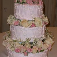 Fluffy Pink Pearl Wedding Cake This was my first wedding cake ever. The pearls were fondant with luster dust. I enjoyed making it but I was unable to finish and put the...