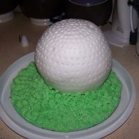 Golf Cake Made with Wilton sports ball pan. Covered in fondant, grass in stiff buttercream.