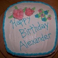 Happy Birthday White chocolate buttermilk cake covered with buttercream icing.
