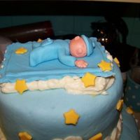 Close Up Of Sleeping In The Clouds Made from fondant with gumtex added.