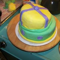Topsy Turvey Almond cake covered in fondant