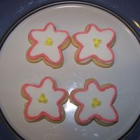 Flowers Sugar cookies covered with MMF and finished off with royal icing.