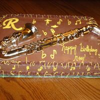 Saxaphone Birthday! Yellow cake with chocolate icing, butter cream designs.