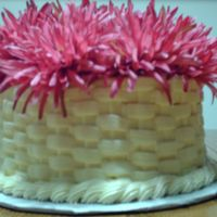 Raspberry Birthday Cake Vanilla cake with raspberry mousse filling, butter cream icing basket weave.