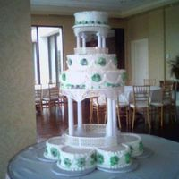 The Crystal Cake tiers are different flavors (lemon pudding, chocolate mocha, french vanilla and stawberry pudding) butter cream icing and royal...