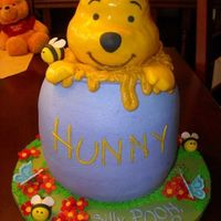 Silly Pooh alternating chocolate and vanilla cake with strawberry mousse, chocolate mousse, and peanut butter mousse. Hunny pot is buttercream. with...