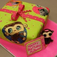 "Littlest Pet Shop Gift I used fondant for covering the cake and most of the decorating. The ""pictures"" were cut from fondant and hand painted. The..."