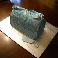 Coach Surprise Made this cake for a friend's wife for Mother's Day. It's a replica of her purse. Vanilla cake with light raspberry mousse...